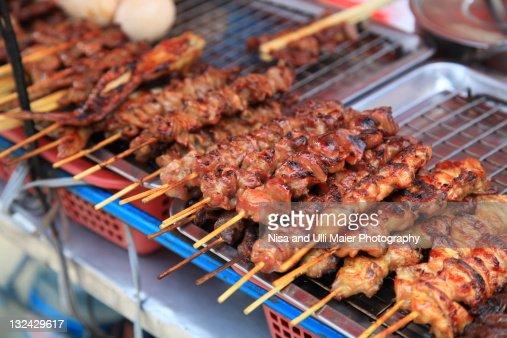 Satay sticks at market in Bangkok, Thailand