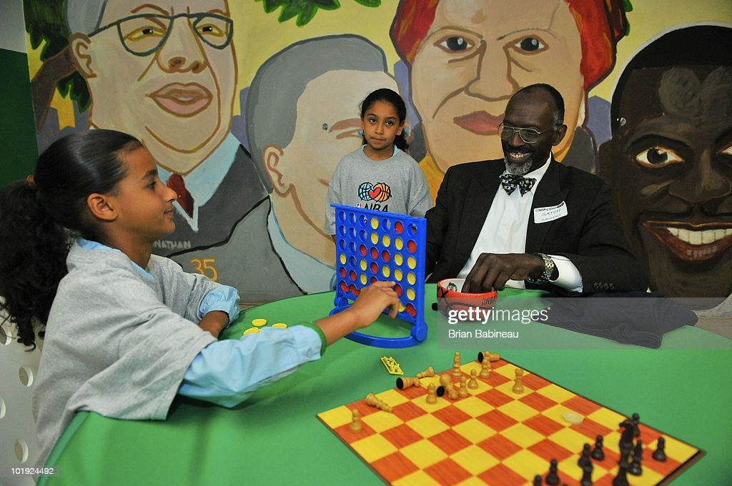 Satch Sanders (R), Celtics legend, plays board games with students during the unveiling of the Learn & Play Center at the Boston Centers for Youth & Families (BCYF) Tobin Community Center on June 9, 2010 in Boston, Massachusetts.