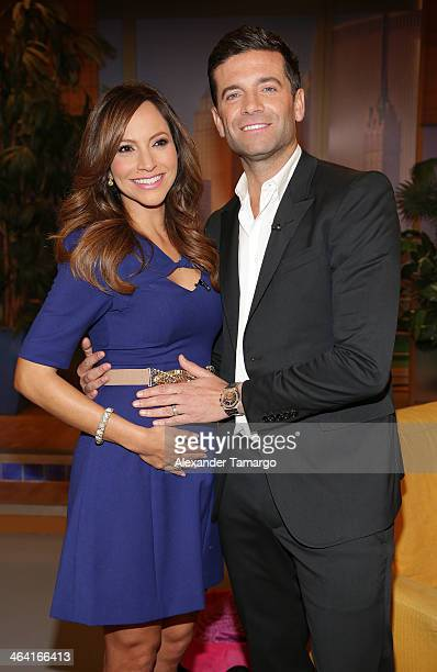 Satcha Pretto and Aaron Butler pose on the set of Univision's 'Despierta America' shortly after announcing that Satcha is pregnant at Univision...