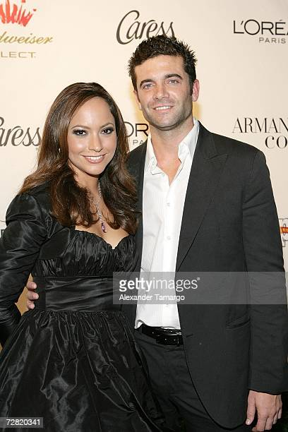 Satcha Pretto and her boyfriend Aaron Butler appear at the People en Espanol Stars of the Year party on December 13 2006 in Miami Florida