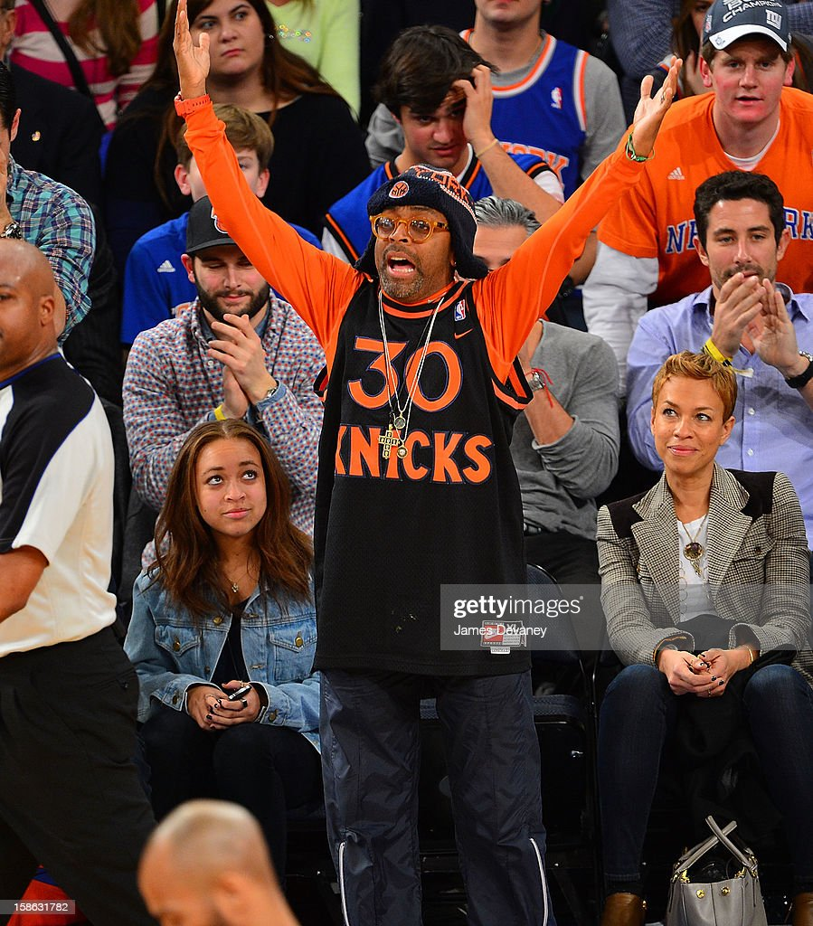 Satchel Lee, Spike Lee and Tonya Lewis attend the Chicago Bulls vs New York Knicks game at Madison Square Garden on December 21, 2012 in New York City.