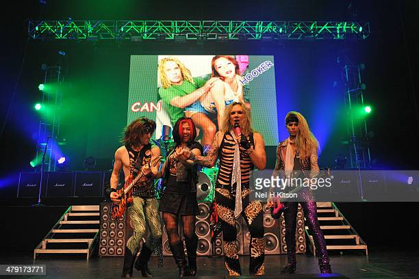 Satchel Stix Zadinia Michael Starr and Lexxi Foxx of Steel Panther performs on stage at Manchester Apollo on March 16 2014 in Manchester United...