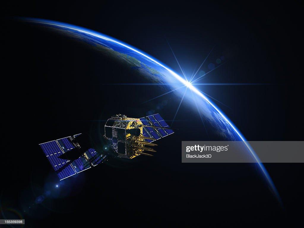 Satellite And Sunrise In Space
