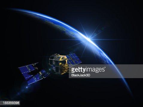 Satellite et le lever du soleil dans l'espace