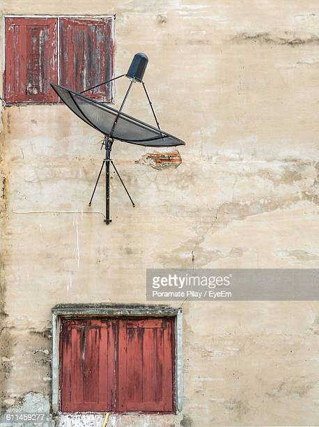 Satellite Dish Against House