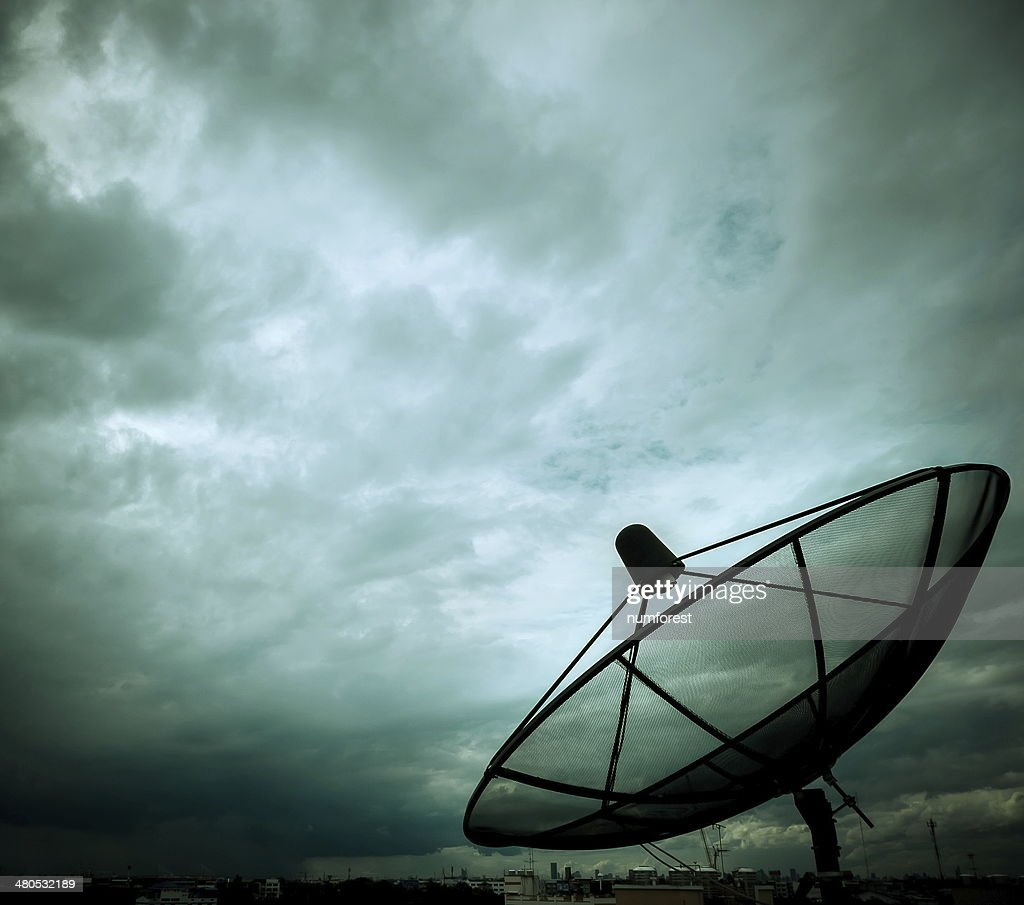 satellite dish and nimbus : Stock Photo