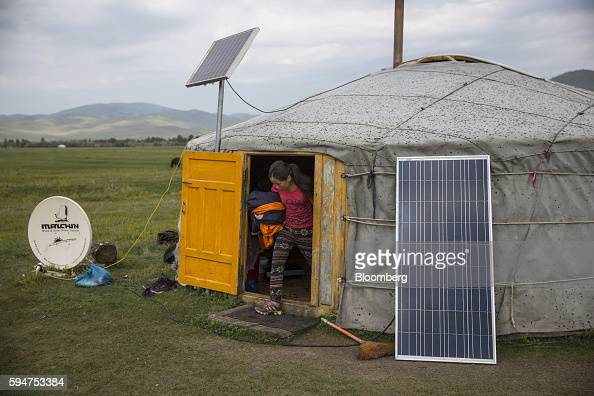 A satellite dish and solar panels sit outside a home in Ikh Tamir Mongolia on Wednesday Aug 3 2016 Mongolia a mineralrich and landlocked $12 billion...