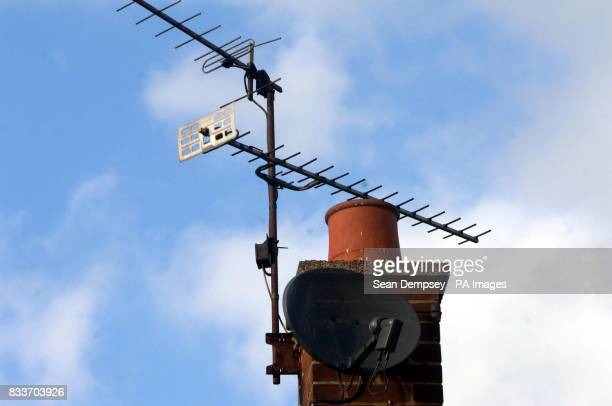 A satellite dish and TV aerial on the roof of a house in Chelmsford