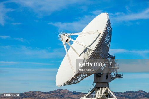 Satellite dish in desert with blue sky