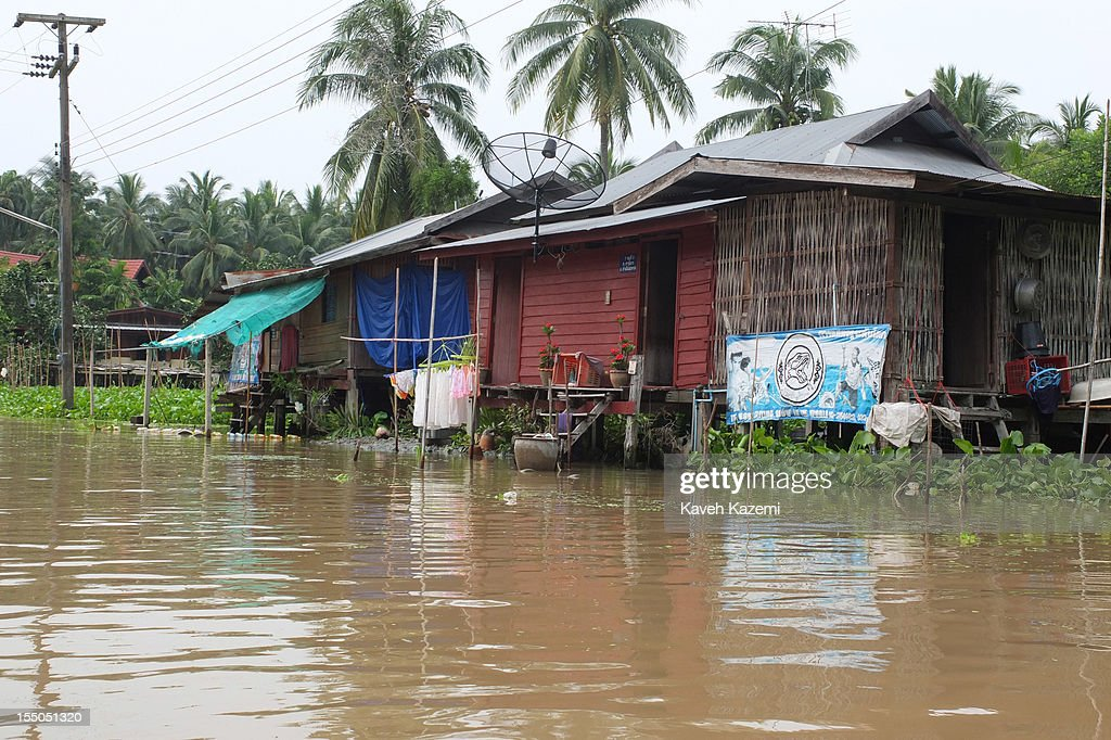 A satellite dish is erected outside a home located in the heart of canals near floating market on October 14 in Damnoen Saduak, Thailand. Damnoen Saduak is a district in the province of Ratchaburi in central Thailand. The central town has become a tourist attraction with its famous floating market.