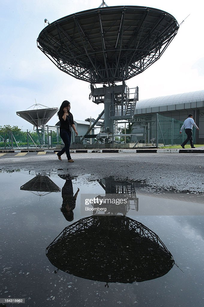 A satellite dish is reflected in a puddle at the Astro Malaysia Holdings Bhd. headquarters in Kuala Lumpur, Malaysia, on Thursday, Oct. 18, 2012. Astro Malaysia, the country's largest pay-TV broadcaster that raised 4.6 billion ringgit ($1.5 billion) in an initial public offering, is scheduled to begin trading at 9am tomorrow. Photographer: Goh Seng Chong/Bloomberg via Getty Images