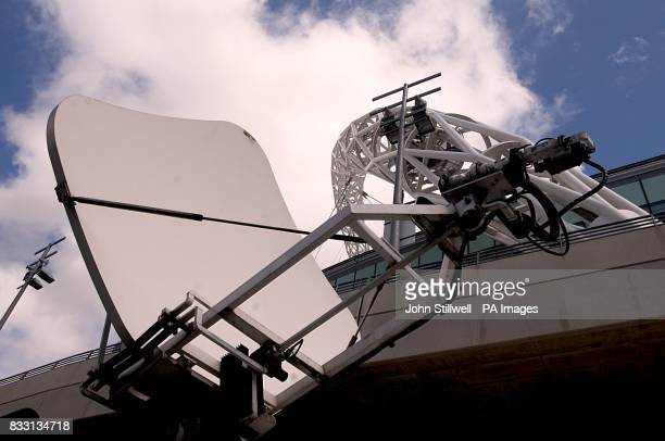 A satellite dish on top of a van parked outside Wembley Stadium London