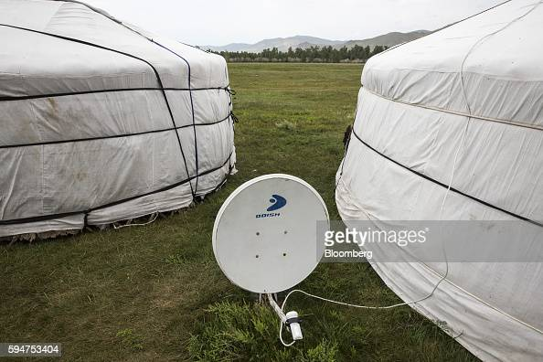A satellite dish sits outside a home in Ikh Tamir Mongolia on Wednesday Aug 3 2016 Mongolia a mineralrich and landlocked $12 billion economy...