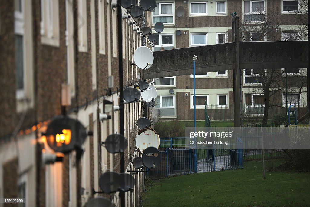 Satellite dishes adorn the walls of homes on the Falinge Estate, which has been surveyed as the most deprived area in England for a fifth year in a row, on January 8, 2013 in Rochdale, England. According to data provided by the Department for Communities and Local Government, 72 per cent of people in the local area are unemployed and seven per cent have never had a job. Four out of five children on the estate are living in poverty, with the area having one of the highest teenage pregnancy rates in the country. During today's House of Commons debate, the government urged MPs to back their planned 1 per cent cap on annual rises in benefits and some tax credits for three years from next April. Benefits for people of working age have historically risen in line with the rate of inflation.