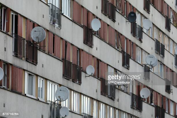 Satellite dishes are seen on the facade of an apartment building part of the Chene Pointu housing estate on November 13 in ClichysousBois northern...