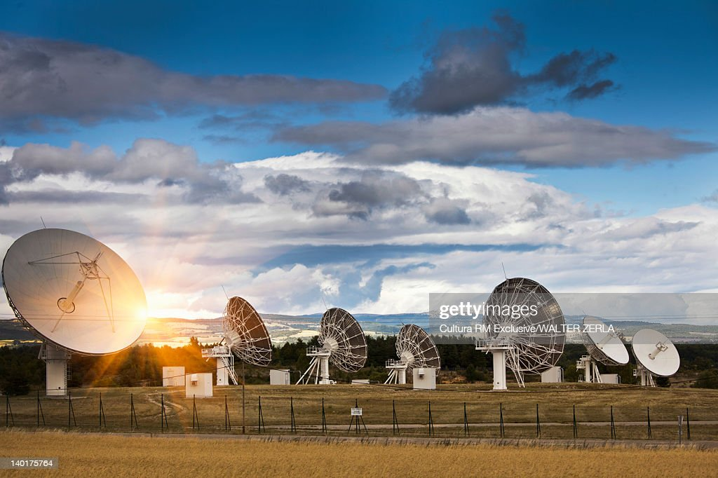 Satellite dishes in rural landscape : Stock Photo