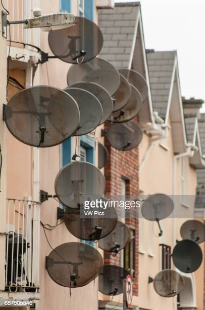 Satellite dishes on a row of houses