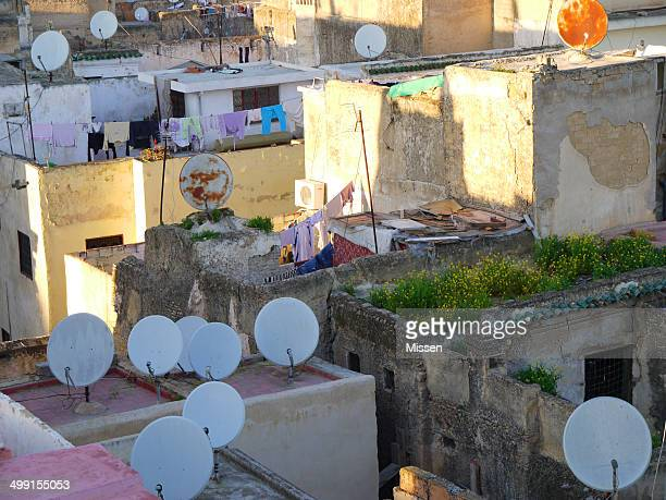 Satellite dishes on city rooftops, Morocco