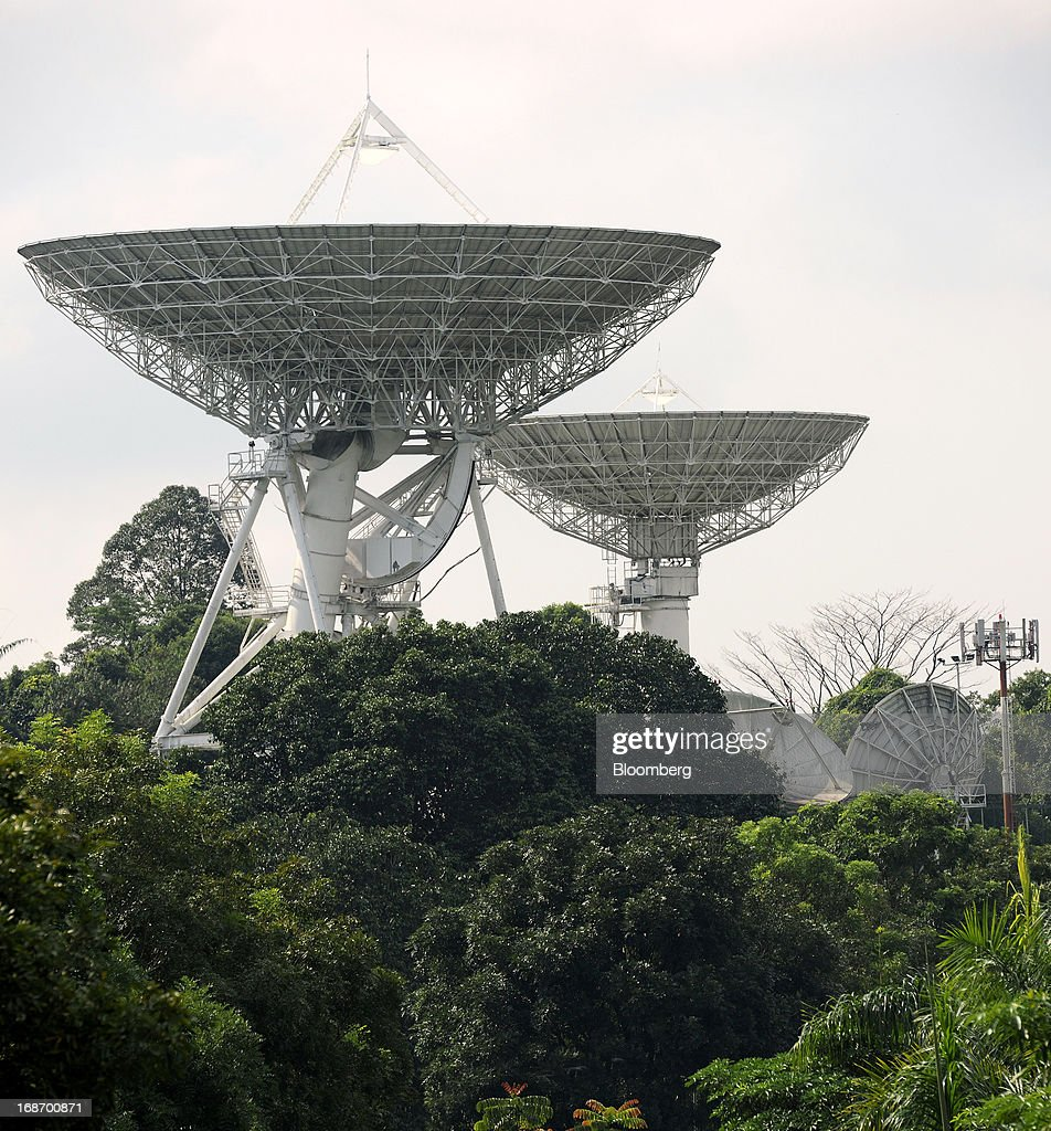 Satellite dishes stand in the Bukit Timah Satellite Earth Station, operated by Singapore Telecommunications Ltd. (SingTel), in Singapore, on Tuesday, May 14, 2013. SingTel, southeast Asia's largest phone company, is scheduled to release fourth-quarter earnings on May 15. Photographer: Munshi Ahmed/Bloomberg via Getty Images