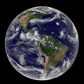 Satellite image of Earth and three tropical cyclones.