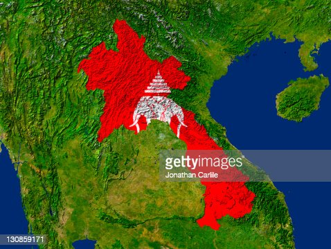 Satellite image of Laos with the country's old flag covering it : Stock Photo