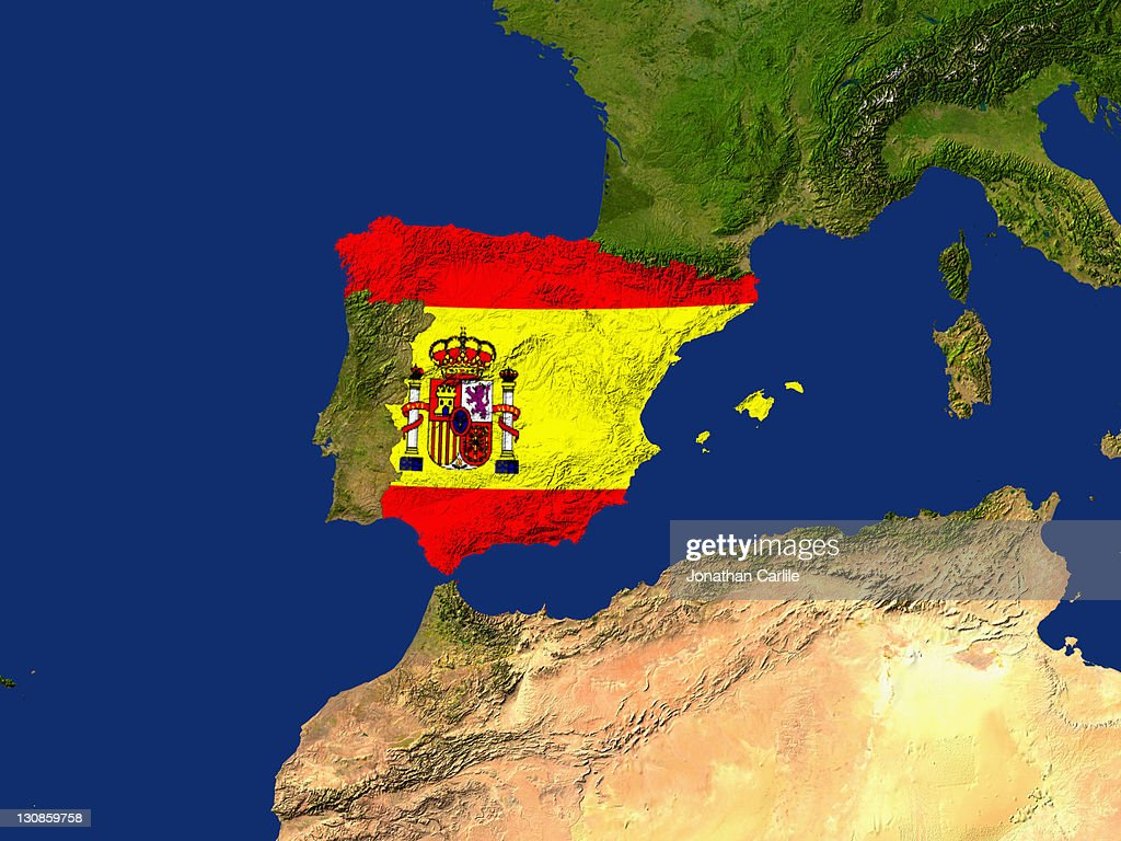 satellite image of spain with the countrys flag covering it stock
