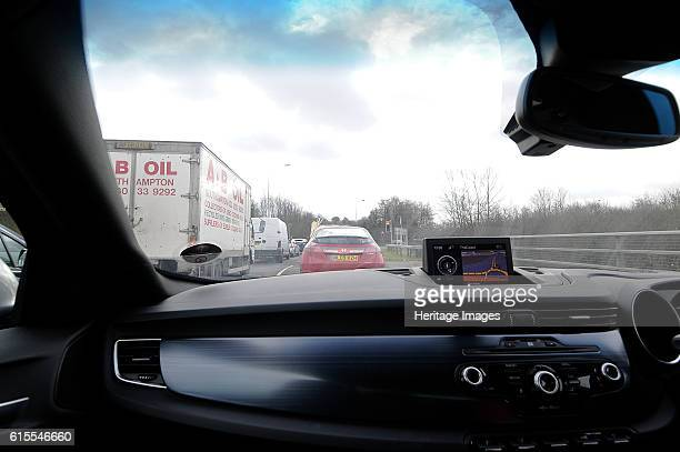 Satellite navigation system in Alfa Romeo Giulietta 2011 in heavy traffic Artist Unknown