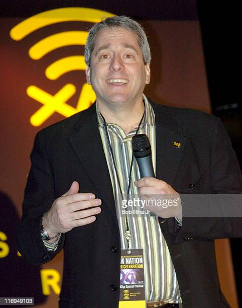 XM Satellite Radio President and CEO Hugh Panero acknowledges cheers from the crowd of XM Radio subscribers and shareholders Dec 1 2004 during a...