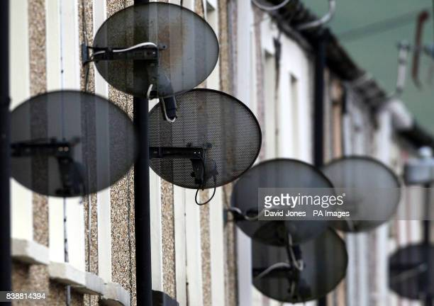 Satellite TV dishes on the side of houses in Birmingham