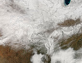 February 10, 20111 09/14/2009 Satellite view of a severe winter storm over the midwestern United States. Nearly all of the white in this image is snow and ice, except for a bit of clouds in the lower