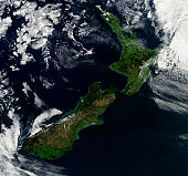 March 30, 2011 - Satellite view of New Zealand. Near the top of the image, snow covers the highest peaks of the North Auckland (Northland) Peninsula. About half-way down the western shore of the penin