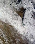 December 7, 2010 09/14/2009 Satellite view of snow and cold across the Midwestern United States. A swath of white defines the path of the storm from Minnesota to Kentucky. Cloud streets streak across