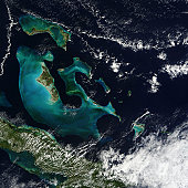 November 10, 2010 09/14/2009 From space, bright peacock blue waters surrounding the Bahama Islands stand out in striking contrast to the deep blue waters of the Atlantic Ocean.  The glowing blue of th