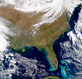 Satellite view of the southeastern United States. Smoke plumes are visible amongst the cloud-free skies.
