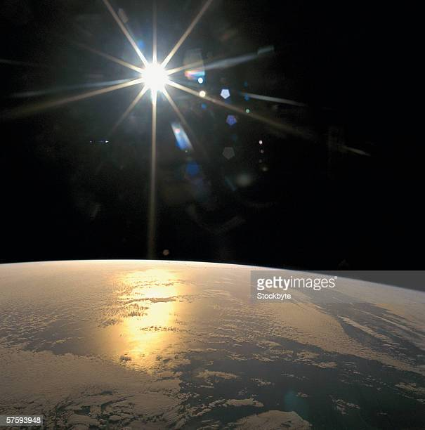 Satellite view of the sunrays falling on the earth's surface