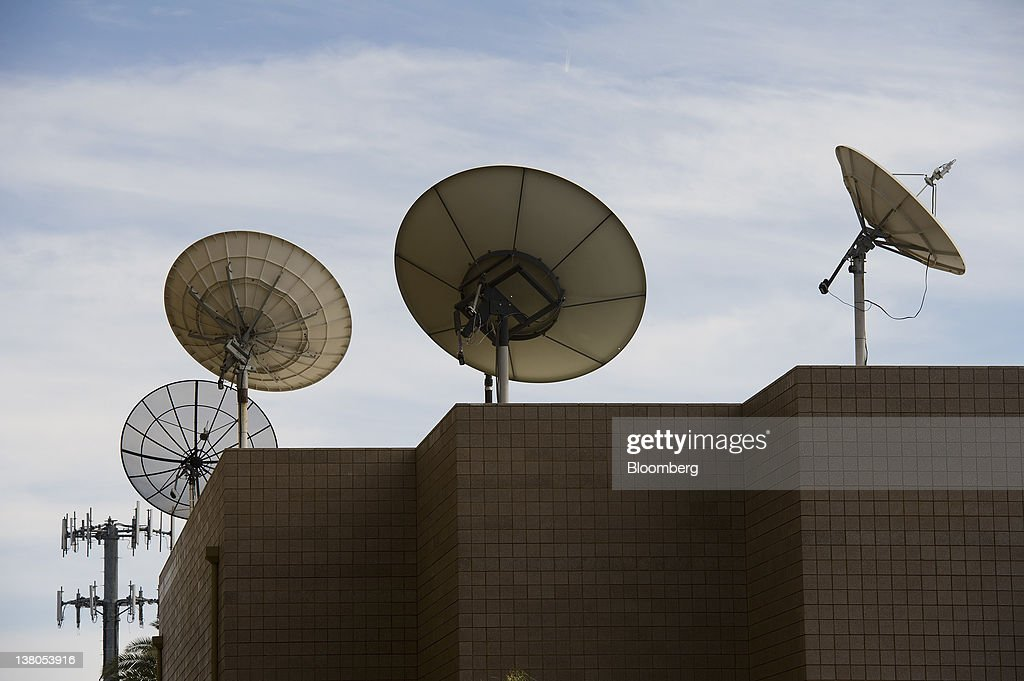 Satellites stand on top of buildings in downtown Las Vegas, Nevada, U.S., on Friday, Jan. 27, 2012. The Nevada Republican presidential caucus will be held on Feb. 4. Photographer: David Paul Morris/Bloomberg via Getty Images
