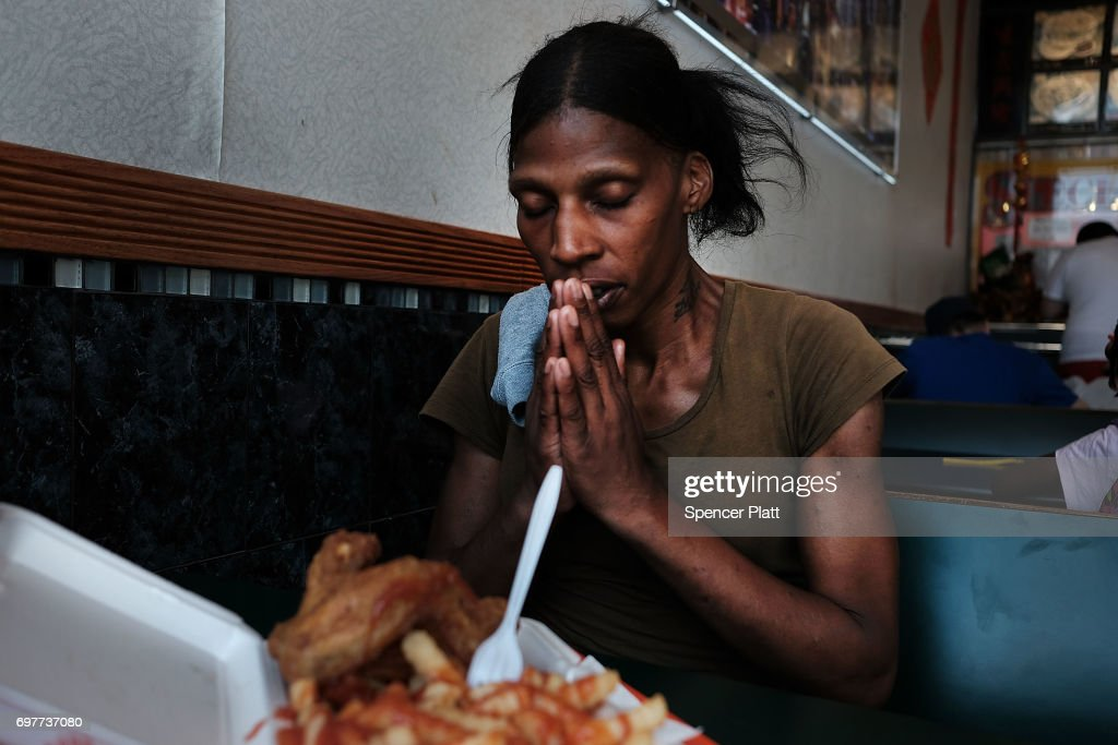 Satiana, a patient at a Brooklyn methadone clinic for those addicted to heroin, prays before she eats a meal as she continues to fight with addiction on June 19, 2017 in New York City. Newly released data shows that over 1,370 New Yorkers died from overdoses in 2016, the majority of those deaths involved opioids. According to the Deputy Attorney General, drug overdoses are now the leading cause of death for Americans under the age of 50.