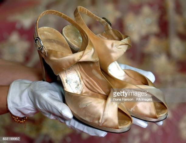 Satin bridal shoes made by Edward Rayne which accompanied the Norman Hartnell wedding dress and 13 foot train worn by the then Princess Elizabeth at...