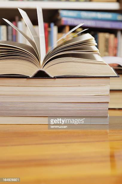 satiric photo of a stack of books and one opened