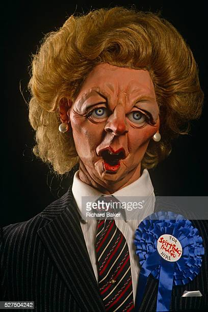 A satirical Margaret Thatcher Spitting Image puppet by Fluck and Law wears a blue Conservative rosette and For Hire sticker Thatcher died on April...