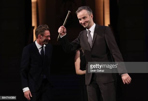 Satirist Jan Boehmermann holds up his award for ADC Honourary Member 2016 at the ADC Night of Honour 2017 on February 23 2017 in Berlin Germany