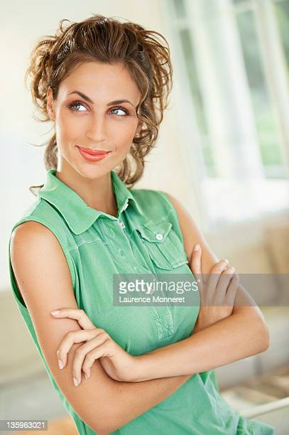Satisfied smiling woman looking on side