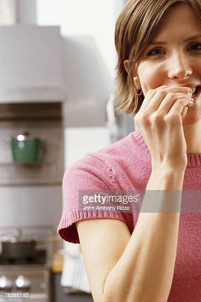 Satisfied woman having snack