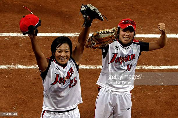Satoko Mabuchi of and Eri Yamada of Japan celebrate Japan's 31 win against the United States during the women's grand final gold medal softball game...