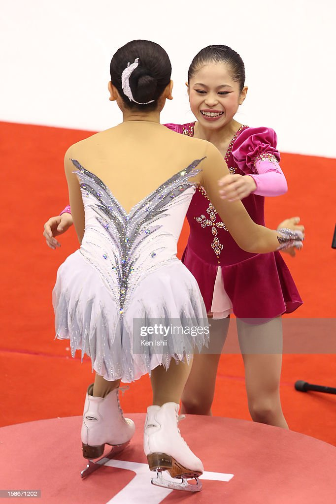 Satoko Miyahara embrance to <a gi-track='captionPersonalityLinkClicked' href=/galleries/search?phrase=Mao+Asada&family=editorial&specificpeople=247229 ng-click='$event.stopPropagation()'>Mao Asada</a> on the podioum after the Women's Free Program during day three of the 81st Japan Figure Skating Championships at Makomanai Sekisui Heim Ice Arena on December 23, 2012 in Sapporo, Japan.