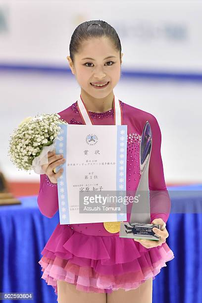 Satoko Miyahara of Japan poses with her gold medal during the day three of the 2015 Japan Figure Skating Championships at the Makomanai Ice Arena on...