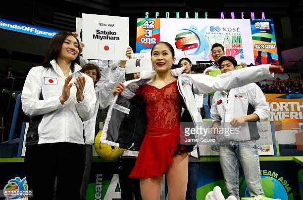 Satoko Miyahara of Team Asia is surrounded and cheered by Captain Shizuka Arakawa and teammates after competing in the Ladies Singles Short Program...