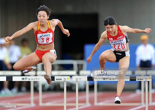 Satomi Kubokura of Japan competes against Yang Qi of China in the women's 400m hurdles final at the Asian Athletics Championships in Kobe on July 9...