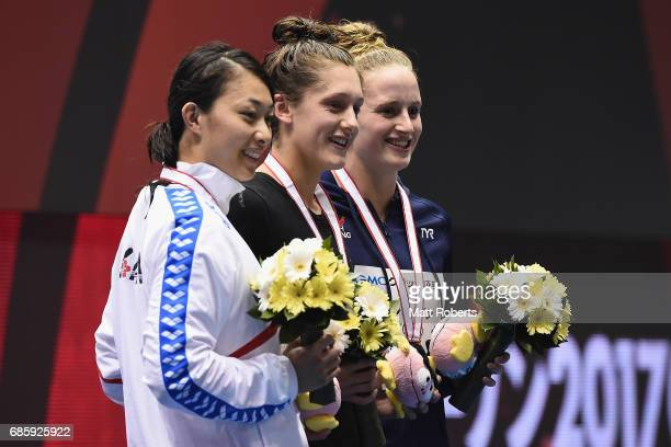 Satomi Suzuki of Japan Imogen Clark and Sarah Vasey of Great Britain pose with their medals on the podium after the 50m Breaststroke Final during the...