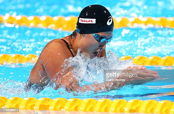 Satomi Suzuki of Team Japan competes during the Swimming Women's 4x100m Medley Relay preliminaries heat two on day sixteen of the 15th FINA World...